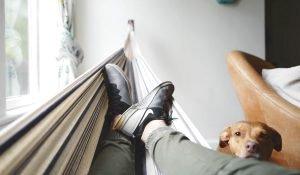 Man in hammock relaxing